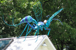 Giant Green Wasp - This giant wasp was made as components and assembled on the roof of this suburban cottage, as delightful to the owner as it was horrific to the neighbors. 12'L x  4'H